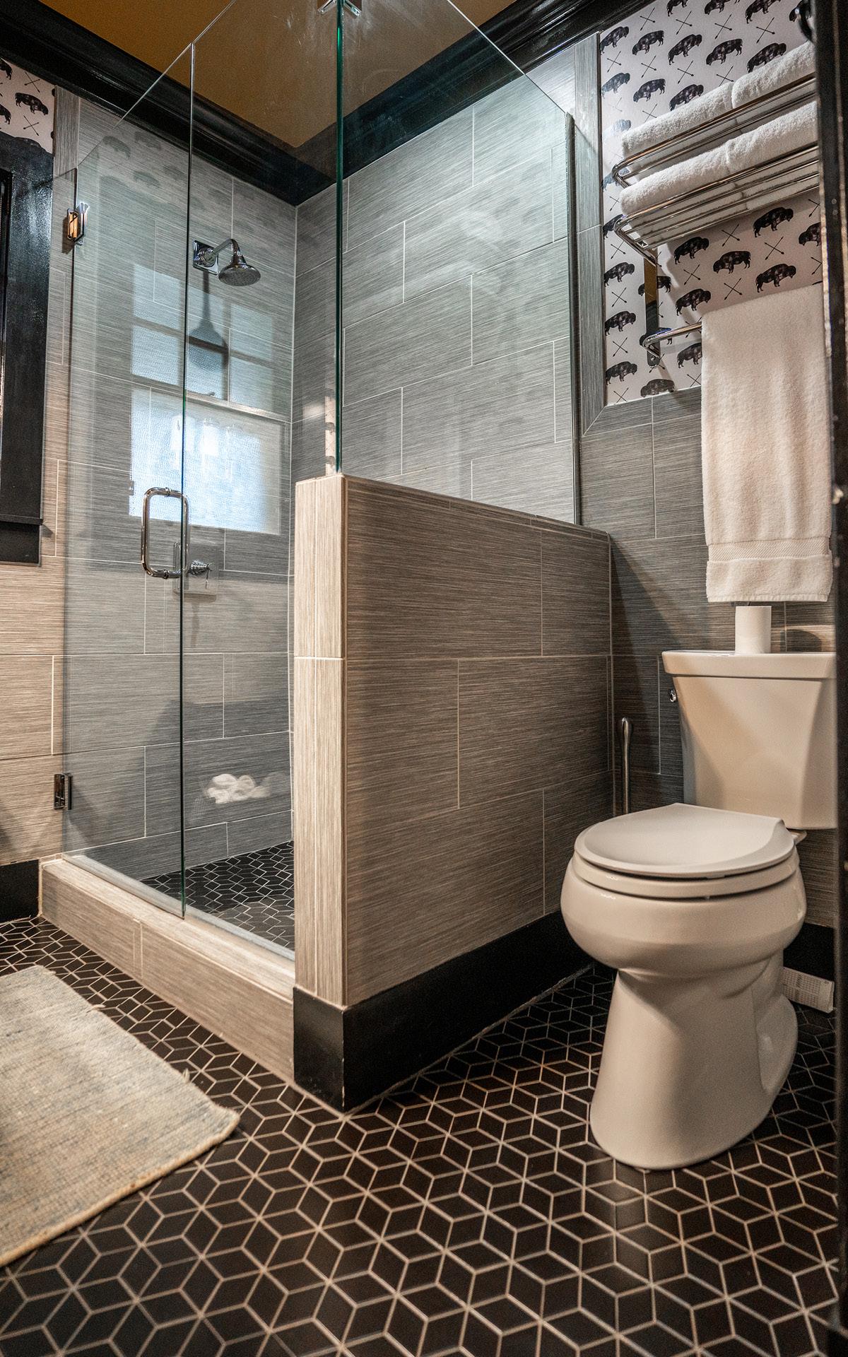 A modern bathroom with walk-in shower