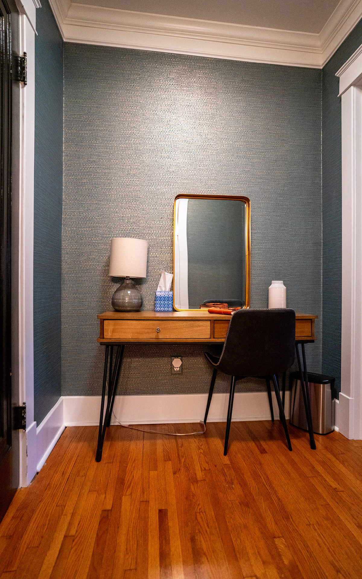 A small desk and mirror for those who bring a little work with them
