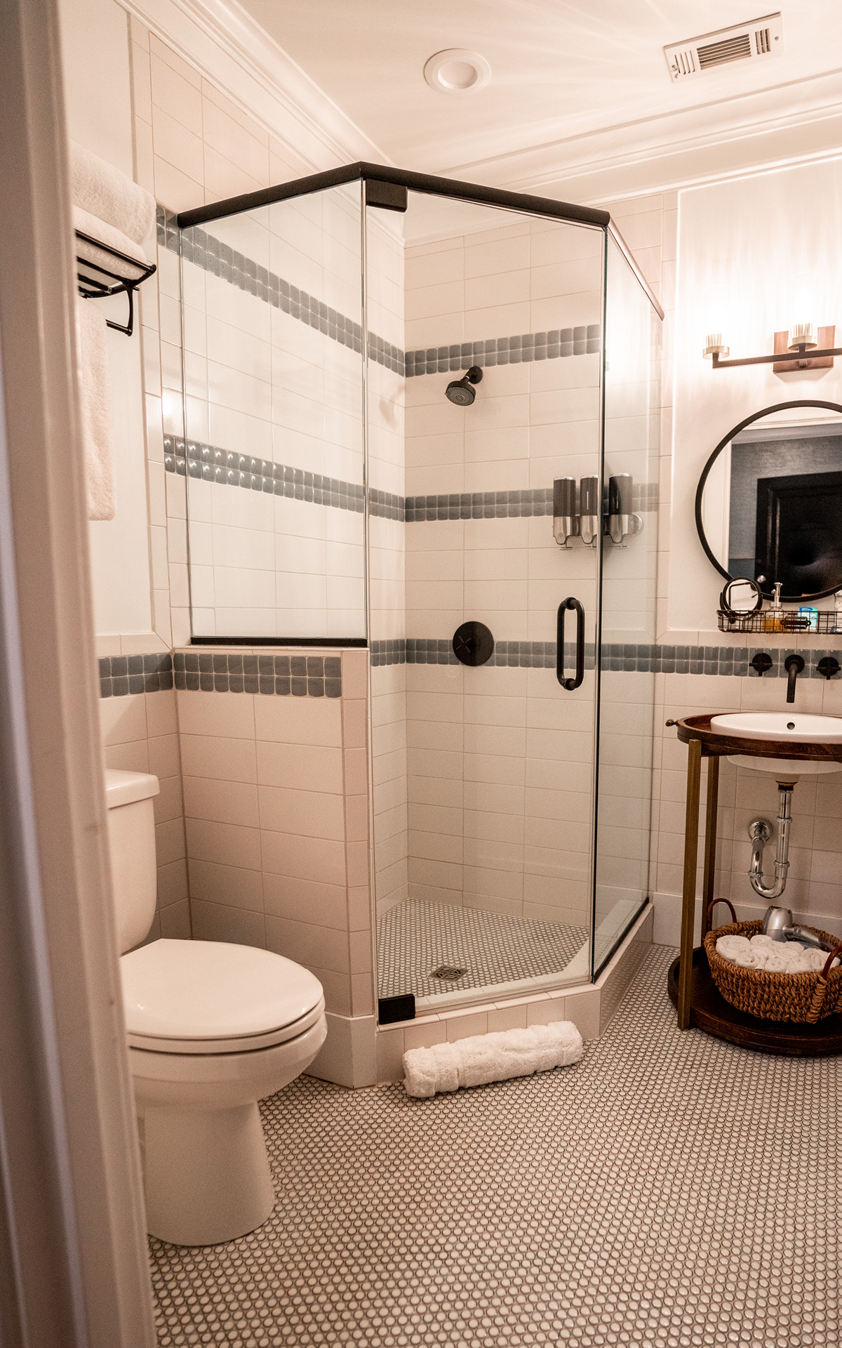 Large walk-in shower in another spotless bathroom