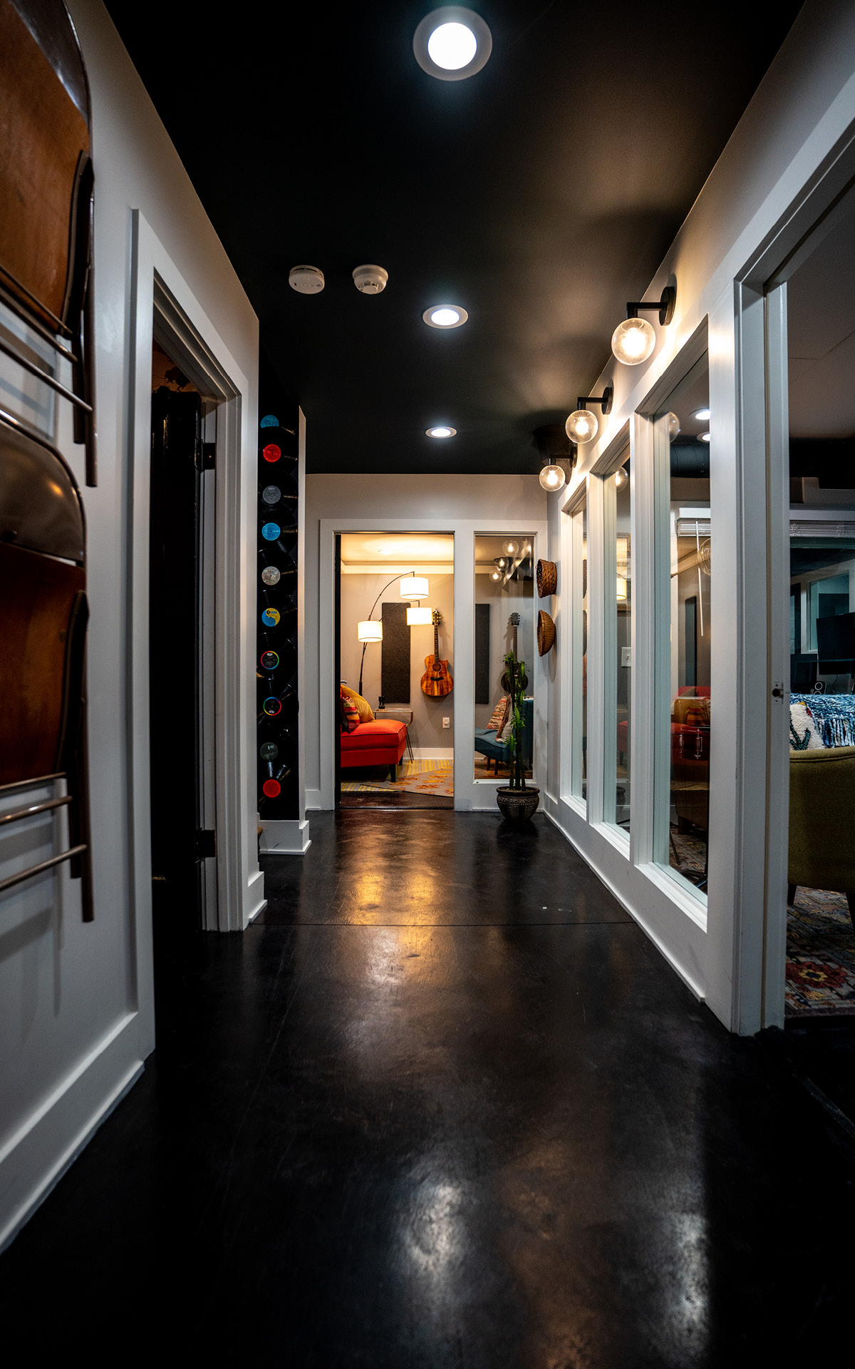 The basement hallway that leads to another office, recording studios, and lounge space