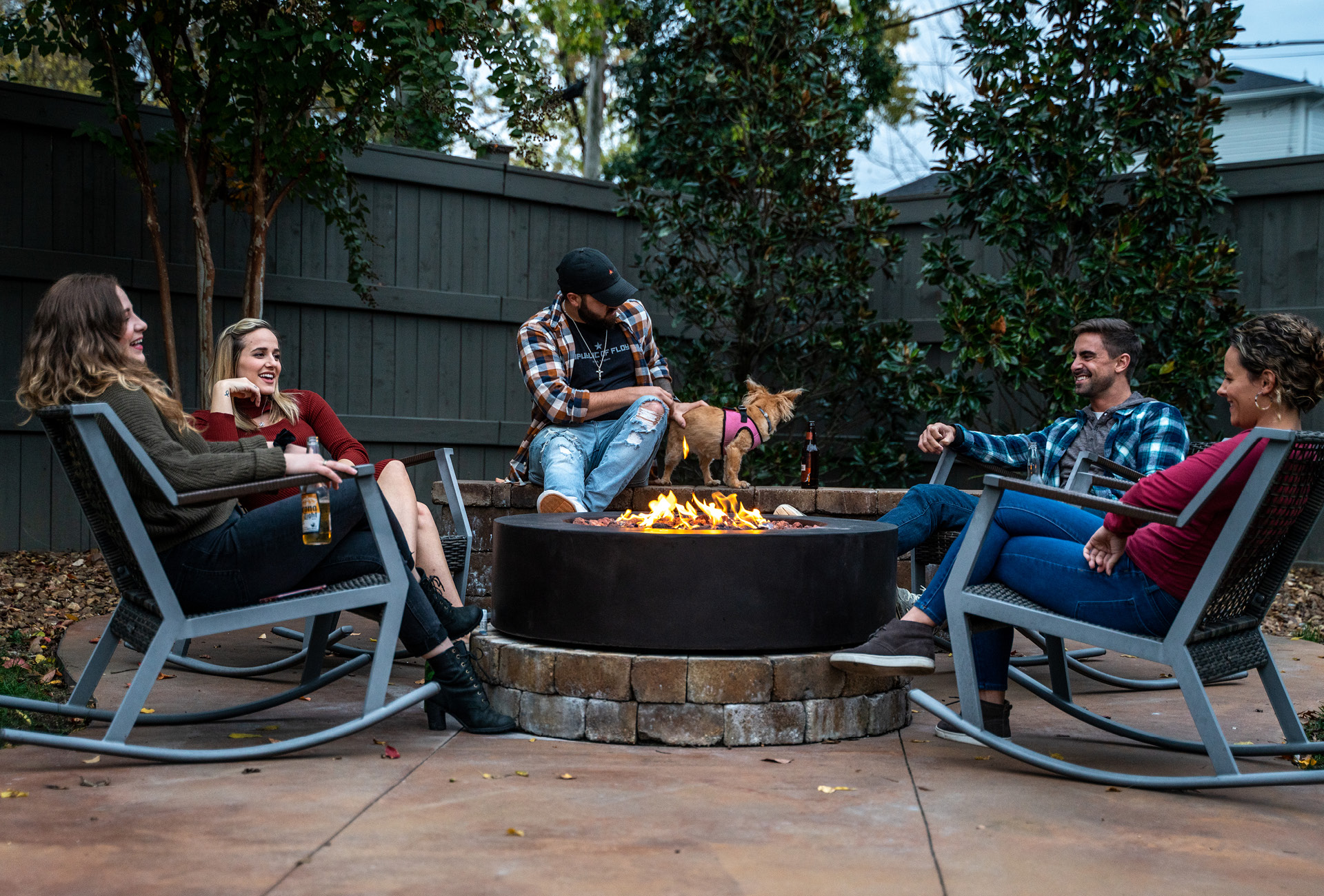 A group of friends around the fire pit